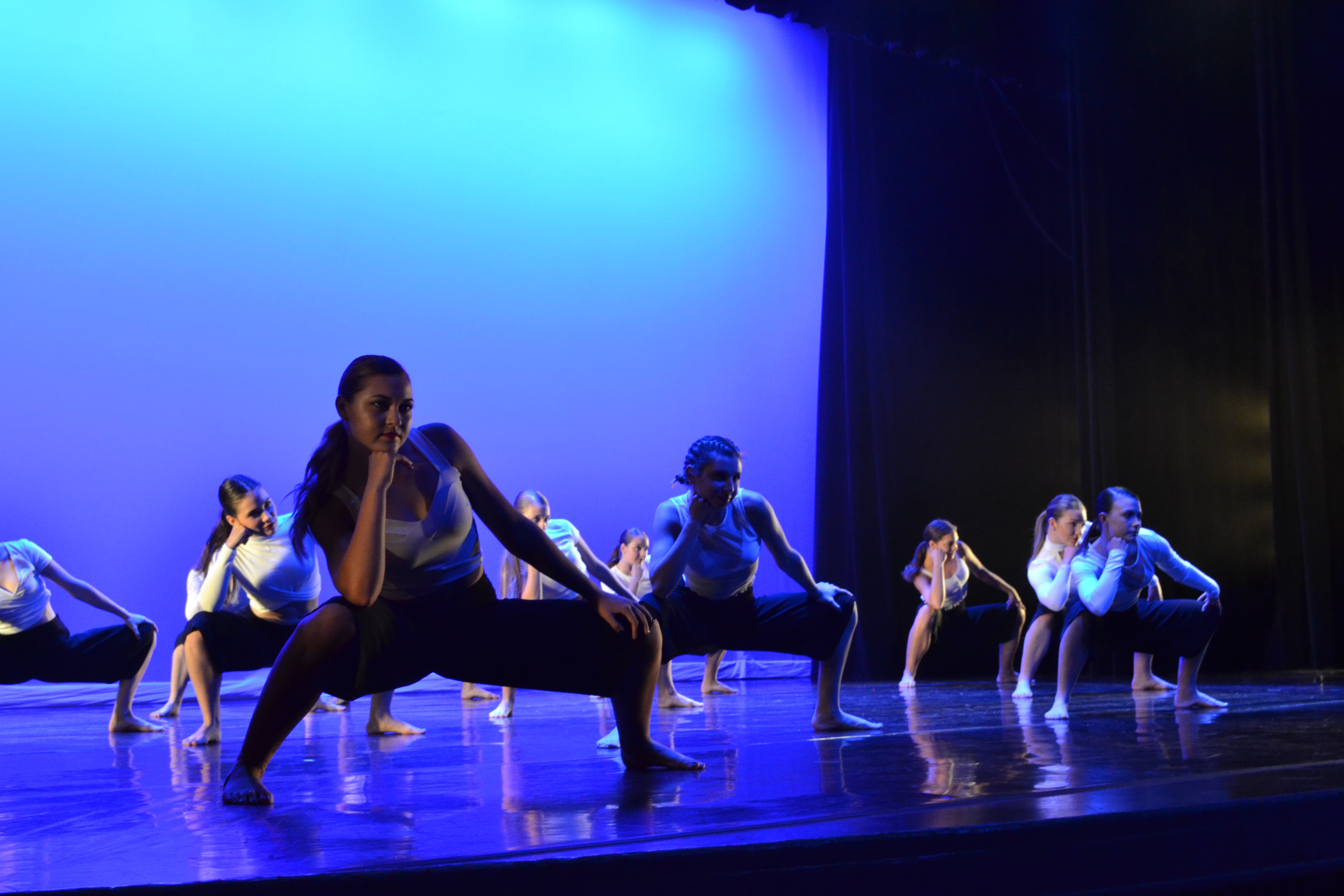 a group of dancers in casual, modern attire