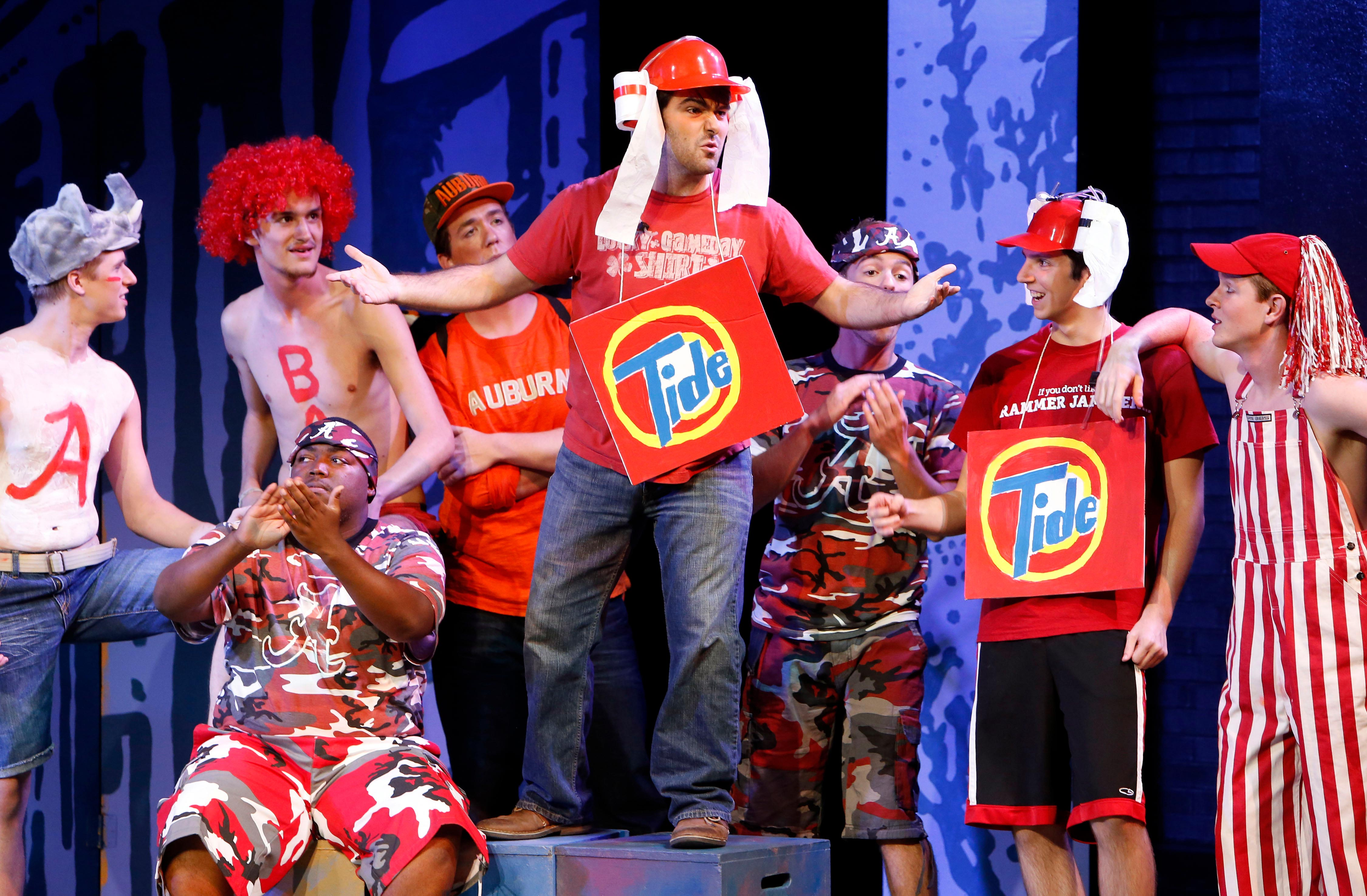 actors in costumes depicting roll and tide with detergent boxes and rolls of toilet paper