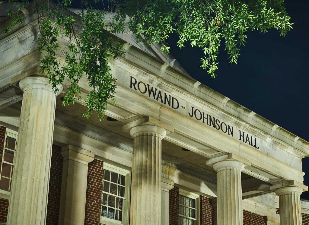 the front of Rowand Johnson Hall, seen at night