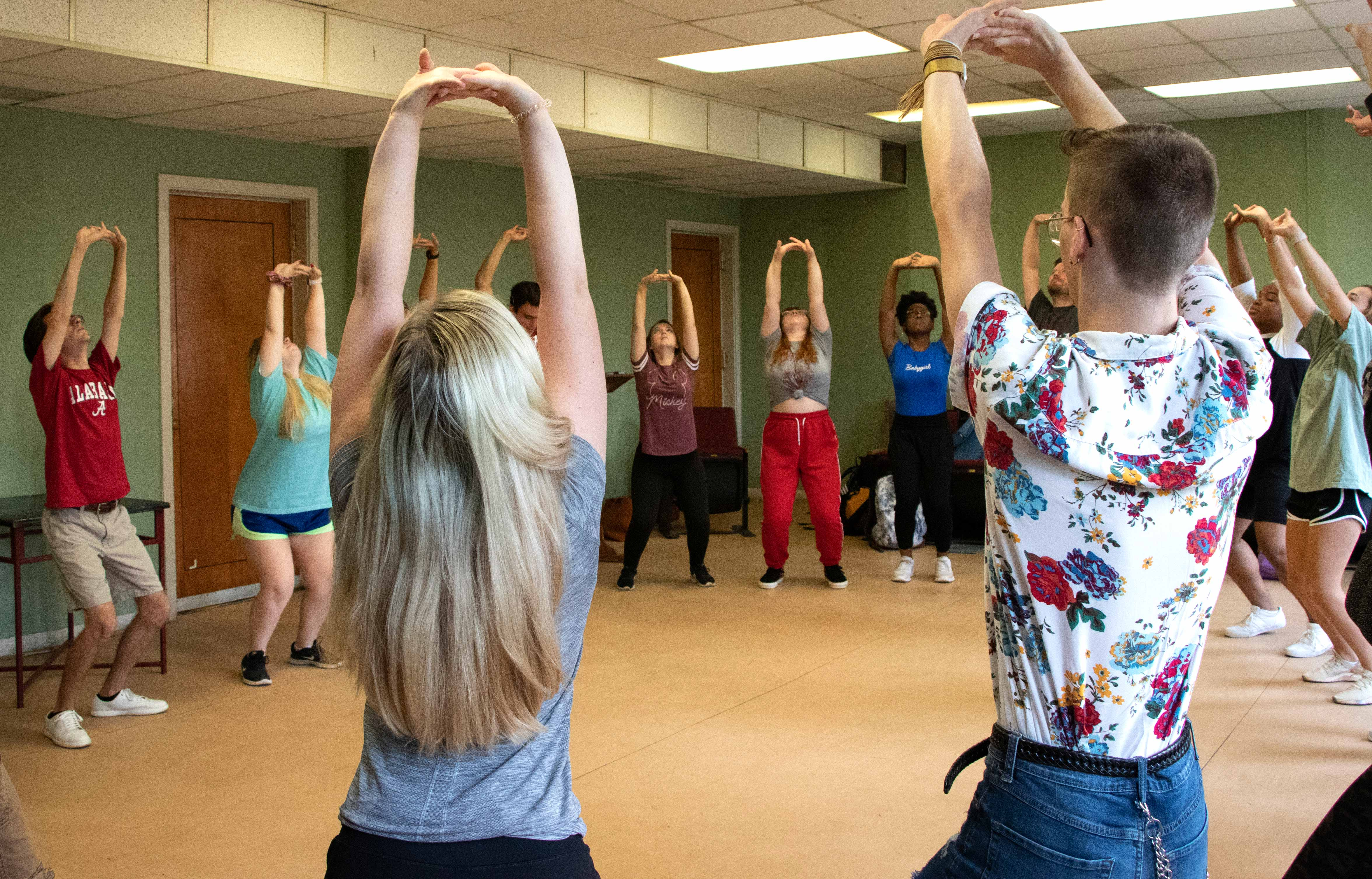students exploring movement in a musical theatre class