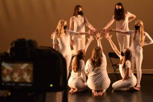 Dancers in front of a camera